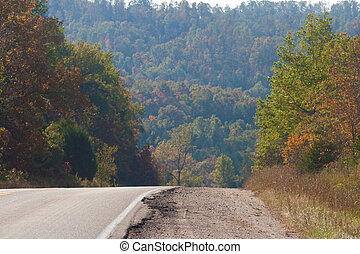 Country Road - A road disappearing into a fall hillside.