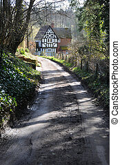 Country road and old cottage near Shere, Surrey, UK