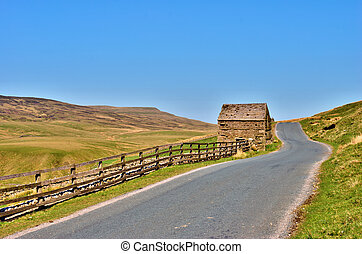 Country road and old stone barn