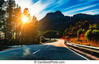 Country road background and colorful sunset landscape.