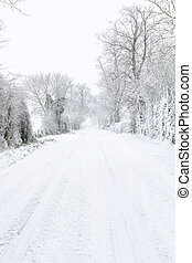 Country road covered in snow in winter