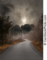 Narrow country road on gloomy autumn day