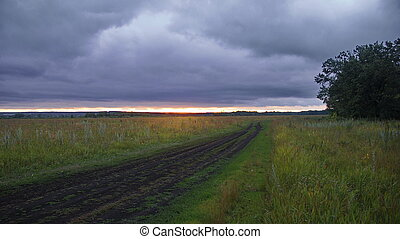 country road in field - Picture of a country road on a...