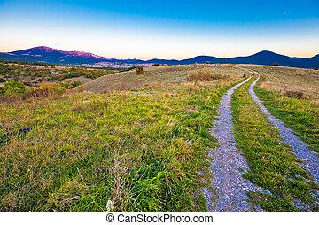 Country road in Lika region landscape