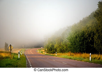 Country road in mist