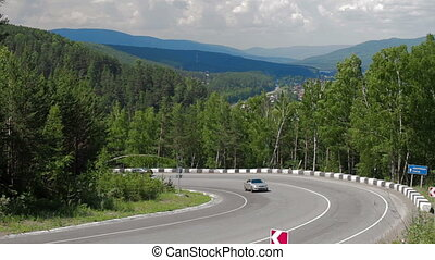 Country road in mountain landscape. Cars traffic