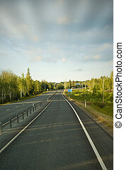 Country road in the summer evening