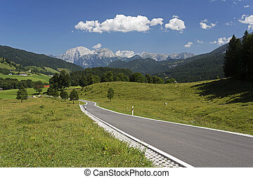 Country road leading to the alps in Bavaria, Germany