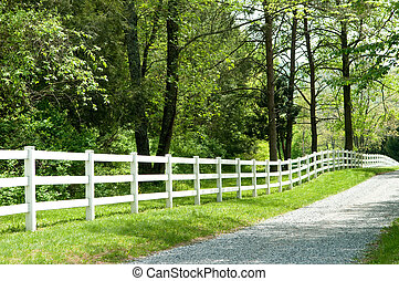 Country Road - Long, private, country road along a white...