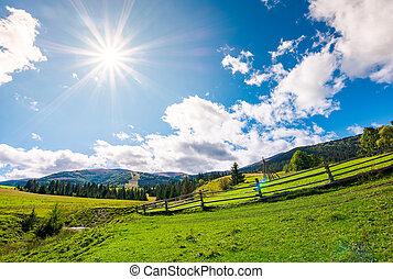 country road through grassy rural hillside. lovely...
