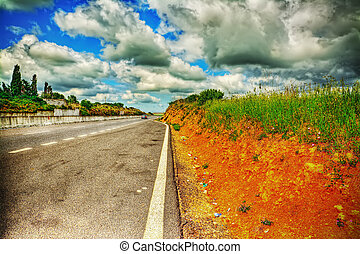 road under a dramatic sky in hdr