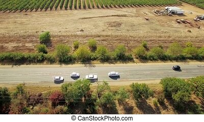 Country Road With Moving Cars Near Garden - AERIAL VIEW....