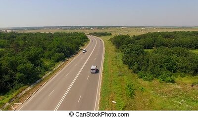 Country Route With Several Cars Moving Fast - AERIAL VIEW....