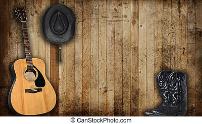 Country scene - Cowboy hat and guitar against an old barn ...