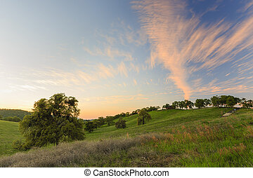 Country side at sunset time with beautiful sky and clouds
