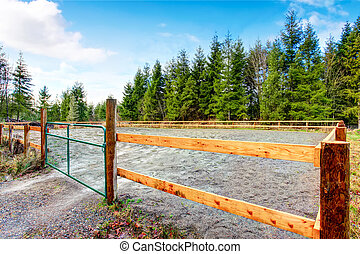 Country side horse farm with wooden fence