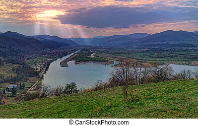 Country side landscape at sunset from the hill, lake and...