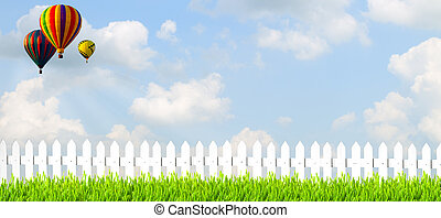 country side with white fence grass and blue sky
