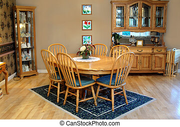 Country Style - Country style dining room has oval, oak...