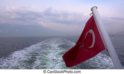 Country Turkey Flag Behind Ferryboat and Sea