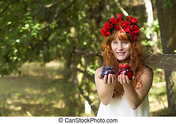 Country woman holding fruits