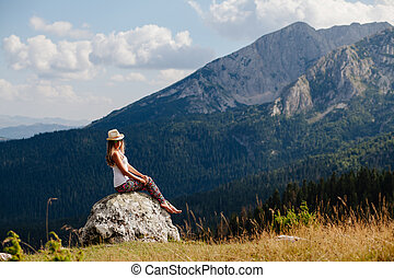 country woman relax in wild nature forest