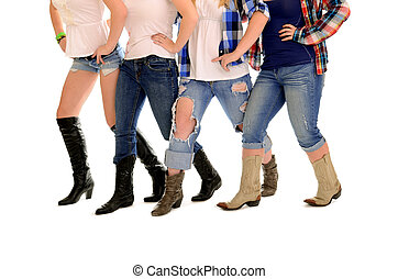 Four Sets of ladies country western legs in cowboy boots line dancing