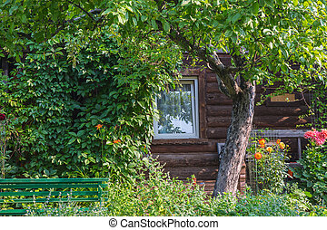 wooden house with blossoming garden