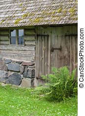 Countryside cabin or farmhouse exterior with mossy roof
