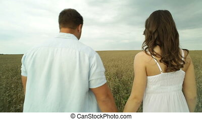 Countryside couple - Rearview of young people spending time...