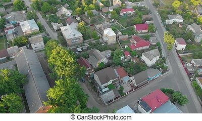 Countryside drone surveillance aerial bird eye view village street suburb private houses