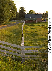 Countryside Fence Leading to A Ranch