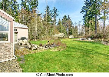 Countryside house. Backyard with patio area