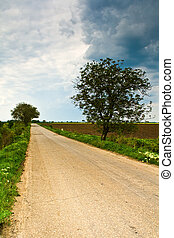 Rural road and cloudy dramatic sky