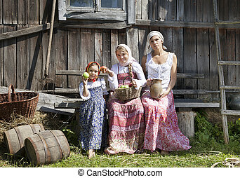 Countryside photograph of a woman with daughters