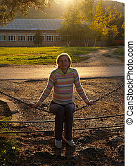 countryside portrait of happy girl against sunset