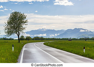Countryside road after rain in Pordenone, Italy.