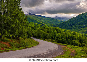 Countryside road in mountains at cloudy sunrise - Empty...