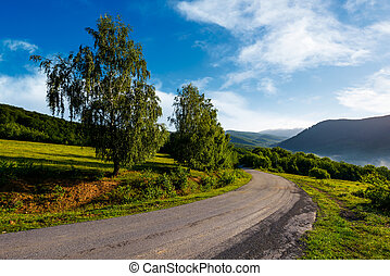 countryside road in mountains. beautiful landscape on fresh...