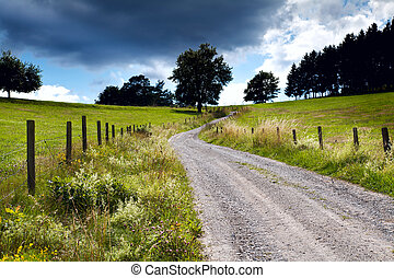 countryside road with fence