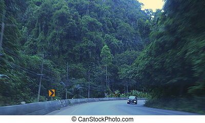 Countryside road with mountains in Asian country in the evening