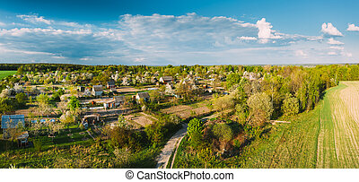 Countryside Rural Landscape With Small Village, Gardens And Green Field In Spring Summer Day. Elevated View. Panorama