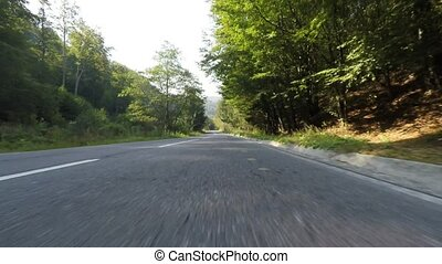 Countryside speeding car with front camera located in the...