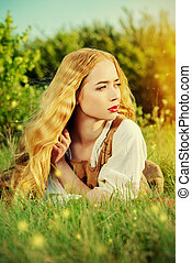 countryside - Beautiful young woman with magnificent blonde...