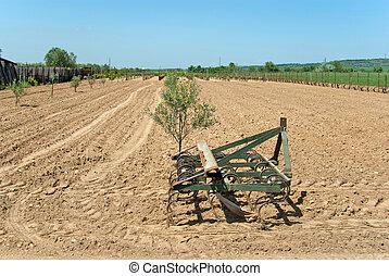 Countryside View of Furrowed Farmland with prairie breaker