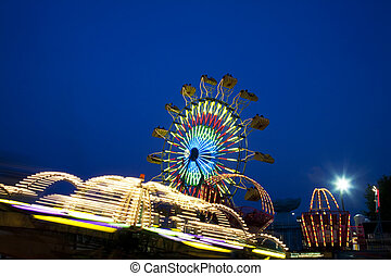 County Fair - Amusement Rides with Movement Blur in the...