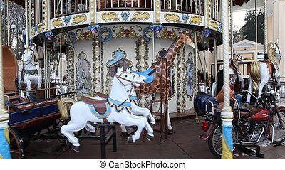 County fair fairground merry-go-round at daytime in winter -...