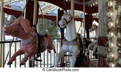 County fair fairground merry-go-round at daytime in winter -...
