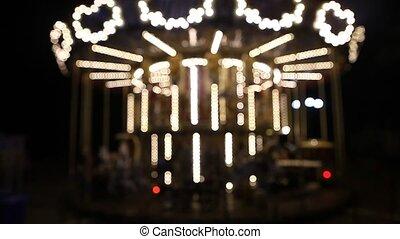 County fair fairground merry-go-round at night