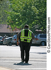 County Police - A local county police officer directing...